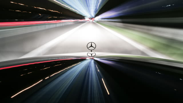on board a black mercedes benz sedan with the bonnet and the hood ornament prominent in frame - driving while night - mercedes benz stock videos & royalty-free footage
