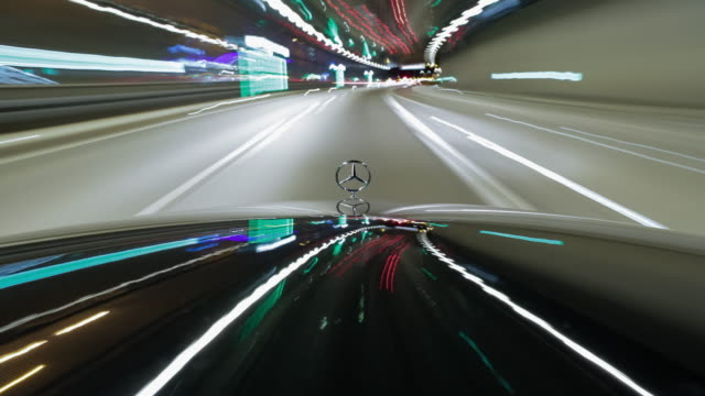 on board a black mercedes benz sedan with the bonnet and the hood ornament prominent in frame - driving while night - vanishing point stock videos & royalty-free footage