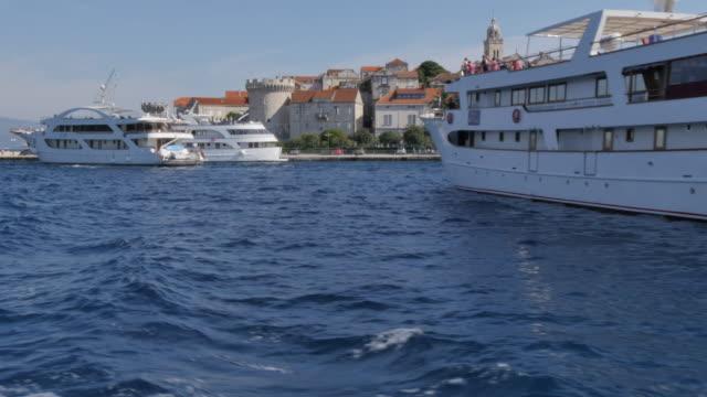 vídeos y material grabado en eventos de stock de on board boat approaching korcula, korcula island, dalmatia, croatia, europe - three quarter length