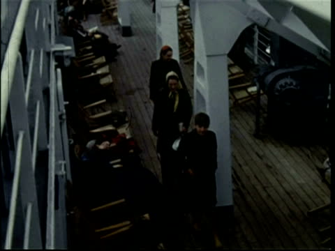1950 on board the gratis ferry, family walk past deck chairs - dover england stock videos and b-roll footage