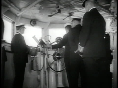 on bridge of ship officers charting course sailors wearing headphones sitting ready at typewriters officer giving order to maintain radio silence - 1935 stock videos & royalty-free footage