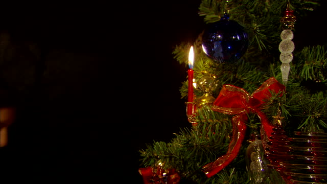 on christmas eve, christmas tree and decoration - candlelight stock-videos und b-roll-filmmaterial