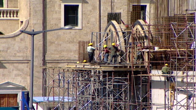 cu on construction workers standing on scaffolding on the construction site of the mohammad alamin mosque in downtown beirut also referred to as the... - blue mosque stock videos & royalty-free footage