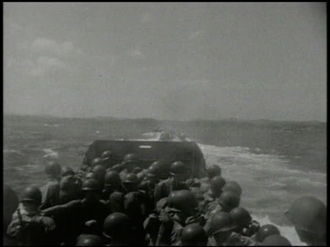 united states soldiers, marines, on board landing craft moving at sea toward unidentifiable land, island. world war ii, wwii, invasion, amphibious... - normandy stock videos & royalty-free footage