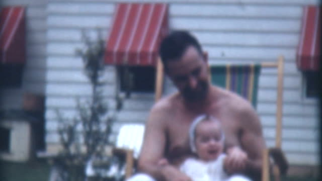 on daddy's lap 1941 - daughter stock videos & royalty-free footage