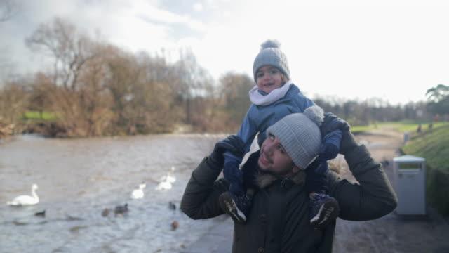 on dad's shoulders! - fun stock videos & royalty-free footage