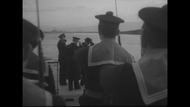 on deck of french cruiser foch, french premier/war minister edouard daladier stands with french officer, color guard with large french flag in front... - french army stock videos & royalty-free footage
