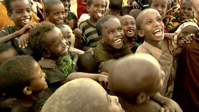 on digital camera at refugee camp refugee children react to seeing their image on a digital camera on july 30 2011 in dadaab kenya - digital camera stock videos & royalty-free footage