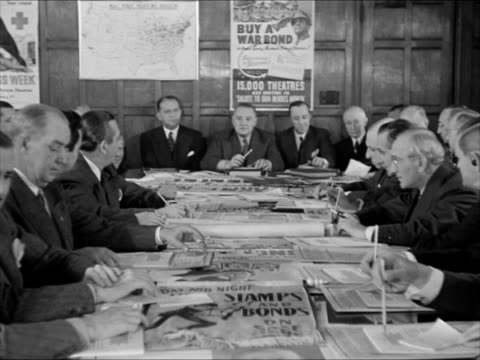 C on door Meeting in progress men working at table Actor Ralph Bellamy passing papers to SAG Founder actor Kenneth Thompson VS Men sitting at table...