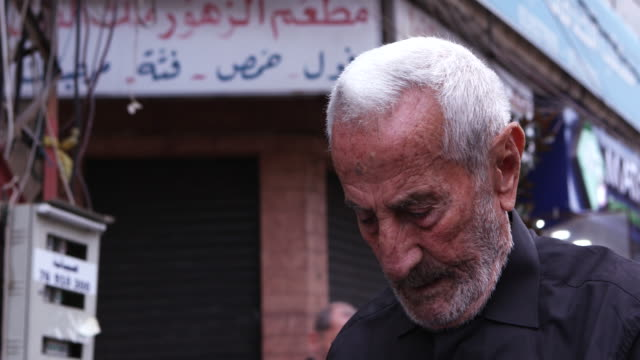 cu on face of a street vendor preparing his stand for customers attending the ashura commerations ashura is the 10th day of muharram commemorating... - ashura muharram stock videos & royalty-free footage