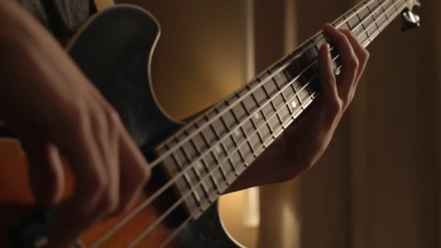 med on hands of bass player - plucking an instrument stock videos and b-roll footage