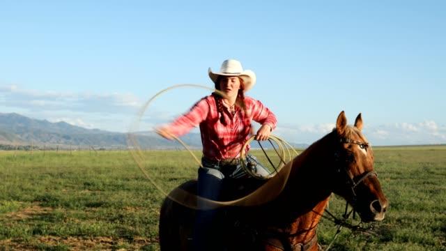 on horseback rope tricks lasso - women doing farm animals stock videos and b-roll footage