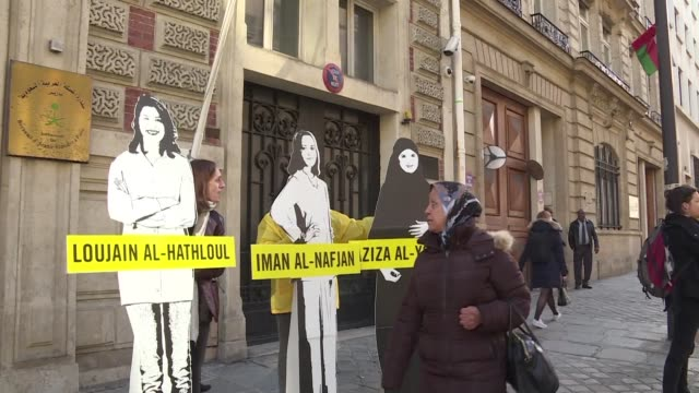 on international women's day amnesty international stages a demonstration at the saudi arabian embassy in paris at which passerby are encouraged to... - saudi arabia stock videos & royalty-free footage