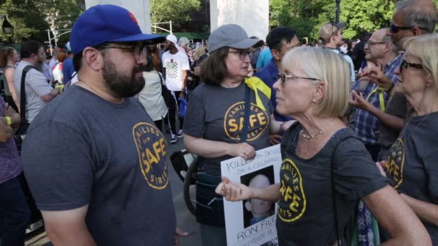 vídeos de stock, filmes e b-roll de on july 9, the #nycbikefamily staged a mass die-in at 6:30 p.m. in washington square park to protest the killing of cyclists in a non-violent,... - number 9