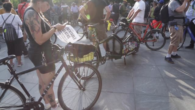 stockvideo's en b-roll-footage met on july 9, the #nycbikefamily staged a mass die-in at 6:30 p.m. in washington square park to protest the killing of cyclists in a non-violent,... - number 9