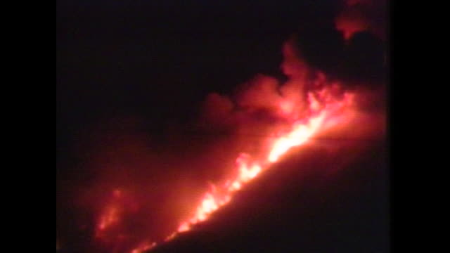 on june 8 the pyroclastic flows blaze away at mount unzenfugendake at night - pyroklastischer strom stock-videos und b-roll-filmmaterial