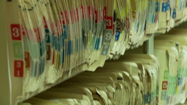 tilt up on medical folders - file stock videos & royalty-free footage