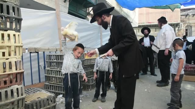 on monday some jews in jerusalem took part in kapparot a customary ritual practiced on the eve of yom kippur which consists of swinging a chicken... - jom kippur stock-videos und b-roll-filmmaterial
