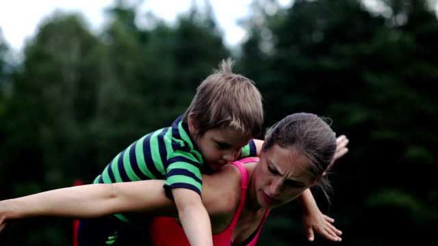 on mummy's back - carrying on shoulders stock videos & royalty-free footage