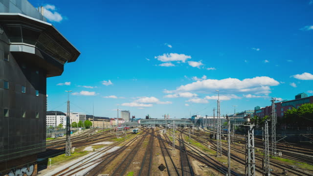 t/l on munich's hackerbruecke overlooking the train tracks towards central station - richtung stock videos & royalty-free footage