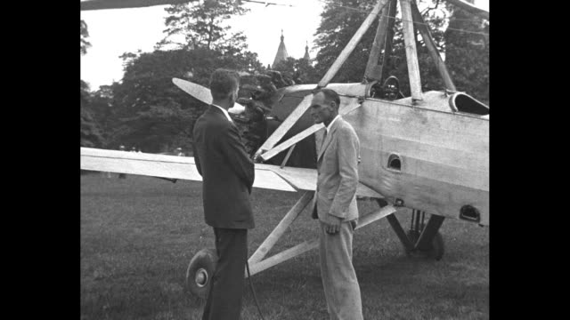 on national mall, smithsonian institution secretary charles abbott sits on nose of c.8w autogiro and talks to pilot james ray / ray and another man... - tail fin stock videos & royalty-free footage