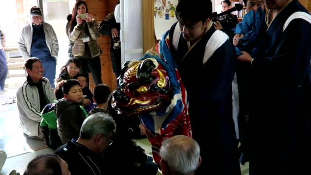 on new year's day traditional kagura sacred shinto music and lion dance briefly consoled evacuees out of home town namie where serious radioactive... - kagura stock videos & royalty-free footage