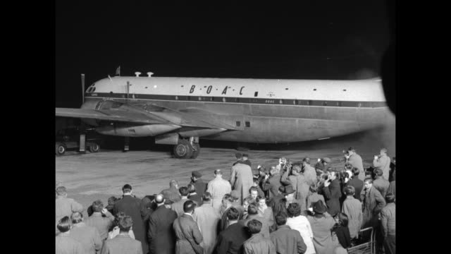 vs on nighttime tarmac boarding stairs are rolled away from boac stratocruiser it belches exhaust as propellers start up as passengers queen... - british empire stock videos & royalty-free footage