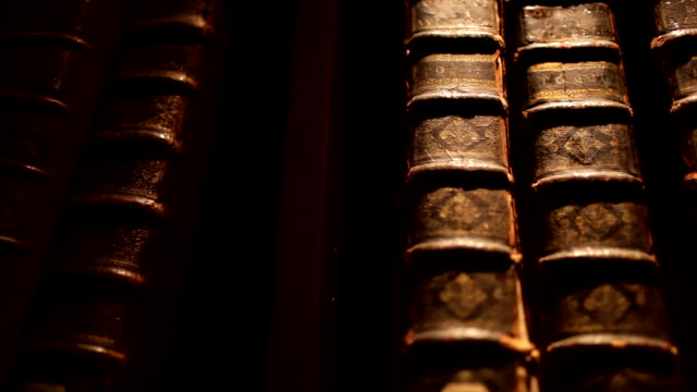 pan on old books in library - ornate stock videos and b-roll footage