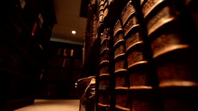 stockvideo's en b-roll-footage met dolly shot on old books in library - plank meubels