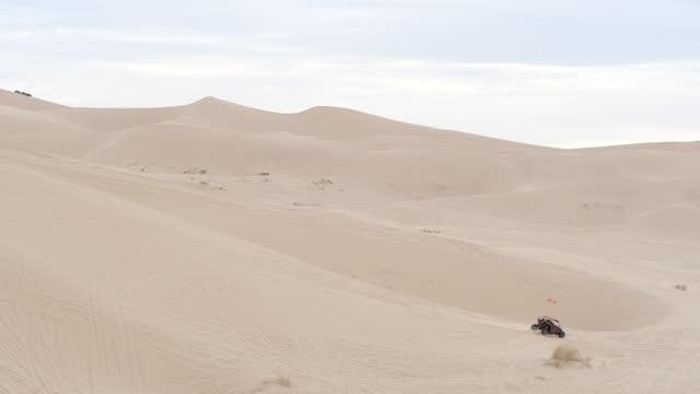atv on sand dunes amidst coronavirus pandemic. - ski resort stock videos & royalty-free footage