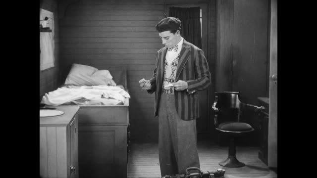 1928 on second thought, a man (buster keaton) pockets a stack of cash - 1928 stock videos & royalty-free footage