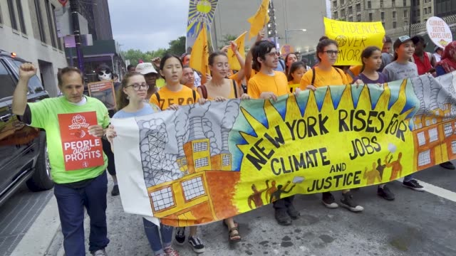 stockvideo's en b-roll-footage met on september 06 demonstrators rallied at lower manhattan's batter park a weekend before the global climate action summit in san francisco scheduled... - cut video transition
