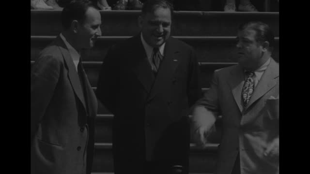 on steps of city hall new york mayor fiorello la guardia shaking hands with lou costello on his left bud abbott standing to their right la guardia... - fiorello la guardia stock videos & royalty-free footage