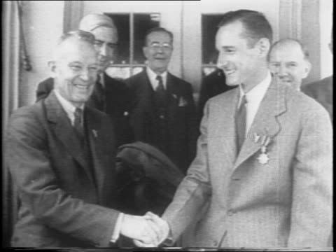 on steps of the white house, pennsylvania seaman edwin f cheney receives medal from admiral emory s land of the maritime commission for saving... - ドリー・マディソン点の映像素材/bロール