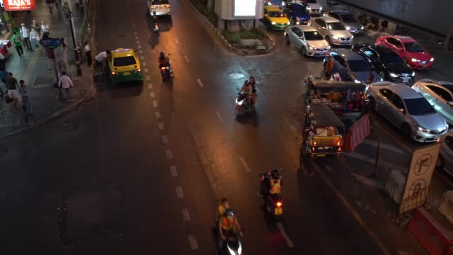 on sukhumvit road. with tuk tuks trying to enter the stream of cars in the centre of shot. one of the most polluted cities on earth as aresult of lax... - carbon monoxide stock videos & royalty-free footage