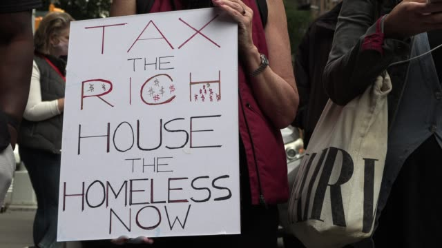 on sunday, october 4, demonstrators and previously homeless residents of the lucerne gathered outside the upper west side hotel to stand against what... - housing difficulties stock videos & royalty-free footage