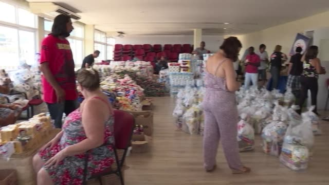 On the 13th floor of a building in central Rio donations of basic necessities stream in for the civil servants of Rio de Janeiro state which is at...