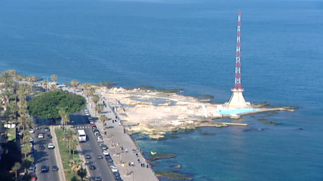 cu on the american university of beirut beach with its own telecom tower at the tip of the beirut peninsula and the seaside road known as the corniche - main road stock videos & royalty-free footage