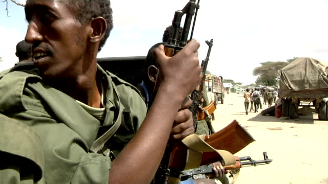 on the back of a pickup truck riding through village Somali militia men on July 31 2011 in Dhoobley Somalia
