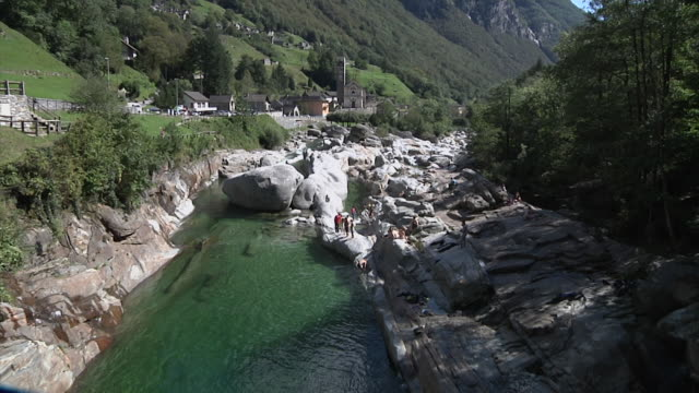 on the banks of the verzasca river. - ticino canton stock videos and b-roll footage