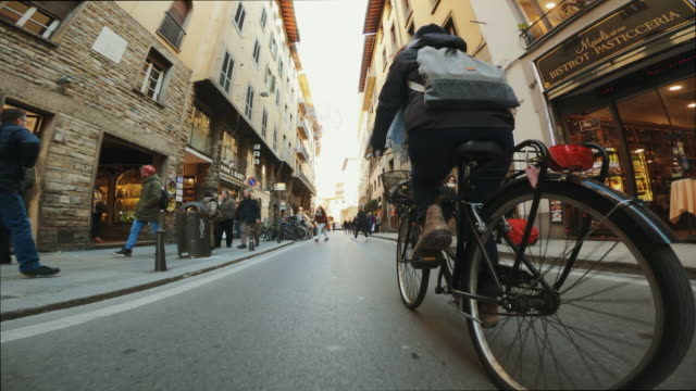 on the bicycle in the streets of florence - tuscany stock videos & royalty-free footage