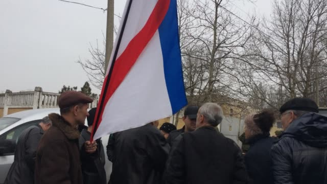 on the day russian soldiers took over the belbek military base in crimea and fired shots at approaching ukrainian soliders, ukrainian demonstrators... - russian ethnicity stock videos & royalty-free footage