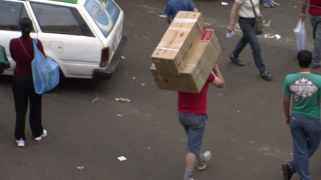 on the edge of three countries, paraguay's ciudad del este is a giant marketplace, the world's third-largest tax-free commerce zone after miami and... - 50 seconds or greater stock videos & royalty-free footage