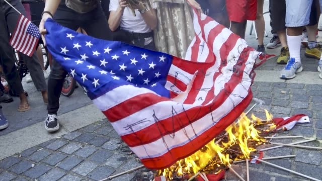 on the eve of july 4 anti-4th of july activist burned the american flag over the death of george floyd and others who were killed by police... - burning stock videos & royalty-free footage