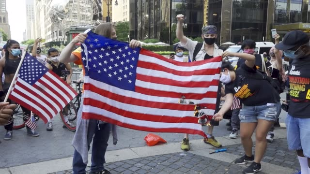 on the eve of july 4 anti4th of july activist burned the american flag over the death of george floyd and others who were killed by police throughout... - fourth of july stock videos & royalty-free footage