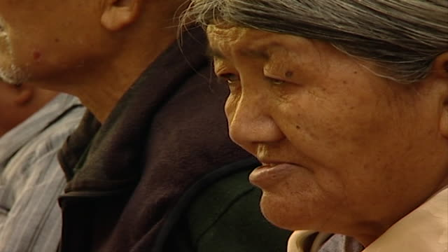 cu on the face of an elderly tibetan worshipper as she listens to hh dalai lama giving a sermon the 14th dalai lama lives in exile in dharamsala - worshipper stock videos & royalty-free footage