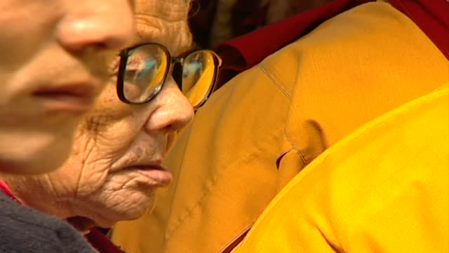 cu on the face of an elderly tibetan worshipper at tsuglagkhang temple listening to hh dalai lama giving a sermon the 14th dalai lama lives in exile... - worshipper stock videos & royalty-free footage