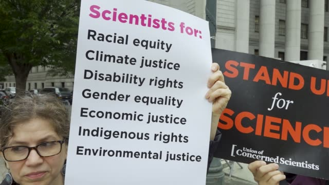 on the first day of a civil lawsuit climate activist from 350org and from rise and resist stand outside of the new york supreme court during a civil... - climate activist stock videos & royalty-free footage