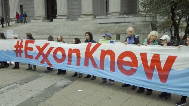 on the first day of a civil lawsuit climate activist from 350org and from rise and resist stand outside of the new york supreme court during a civil... - responsibility stock videos & royalty-free footage