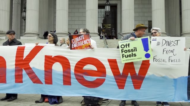 on the first day of a civil lawsuit climate activist from 350org and from rise and resist stand outside of the new york supreme court during a civil... - generalstaatsanwalt stock-videos und b-roll-filmmaterial